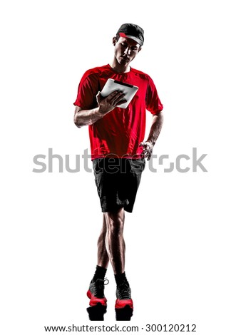 one young man runner jogger using digital tablets in silhouette isolated on white background - stock photo