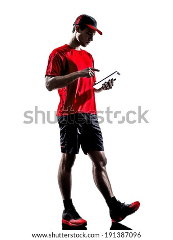 one young man runners joggers using digital tablets ipad in silhouettes isolated on white background - stock photo