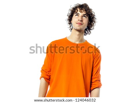 one young man suspicious  caucasian looking up portrait  in studio white background - stock photo