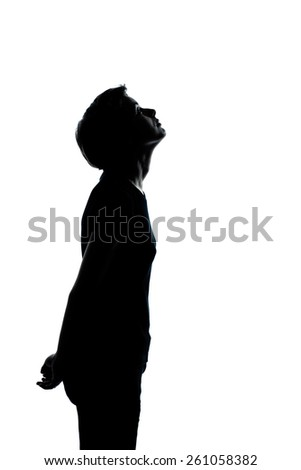 one young teenager silhouette boy or girl portrait in studio cut out isolated on white background - stock photo