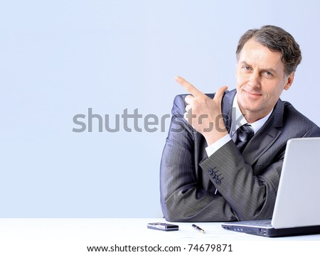 onfident business man with a laptop at the office - stock photo