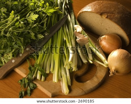 onion, bread, knife and parsley - stock photo