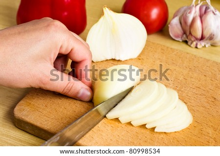 Onion cutting - stock photo