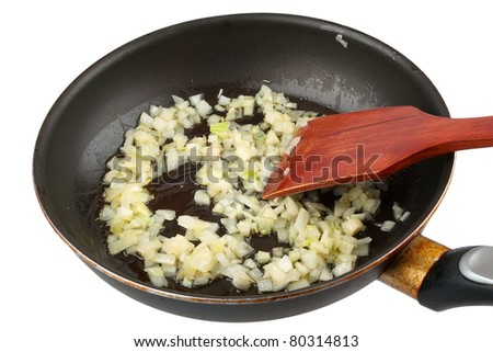 Onion frying in a pan isolated on white background - stock photo