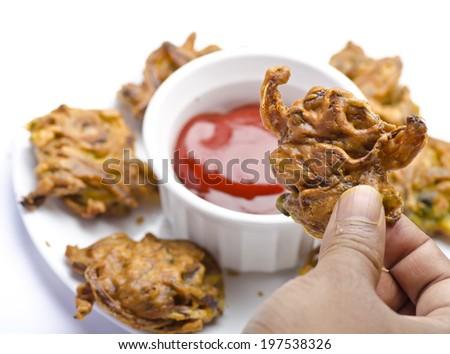 Onion pakoda with kechup - stock photo