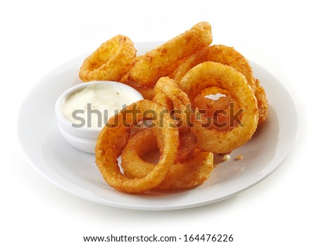 onion rings and dip sauce isolated on white plate - stock photo