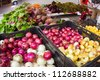 Onions and assorted vegetables at organic farmers market - stock photo