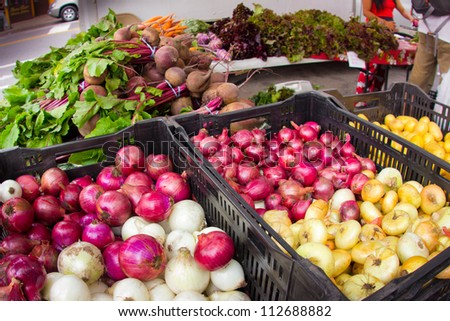 Onions and assorted vegetables at organic farmers market