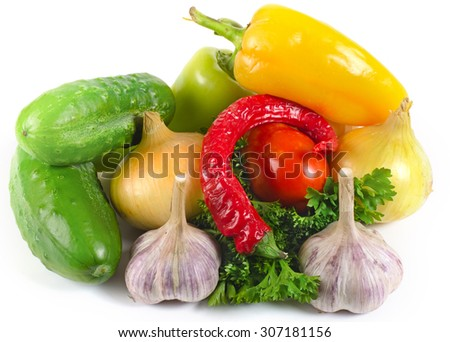 onions, garlic, parsley leaves, tomato, pepper, cucumbers lie on a light surface