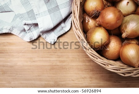 onions in a basket - stock photo