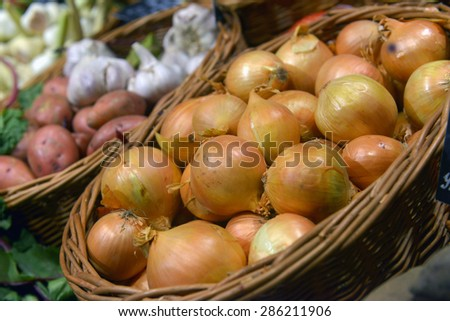 Onions on display in a supermarket - stock photo