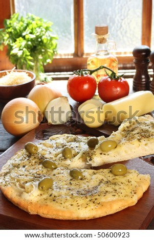 Onions pizza with olives and ingredients - stock photo