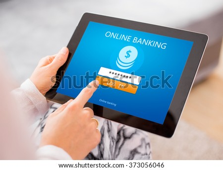 Online banking on tablet computer - stock photo