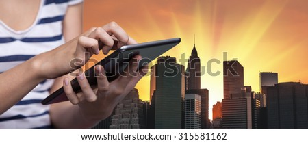 Online Booking. Hotel reservation via Internet. Young woman uses a tablet PC for hotel reservation
