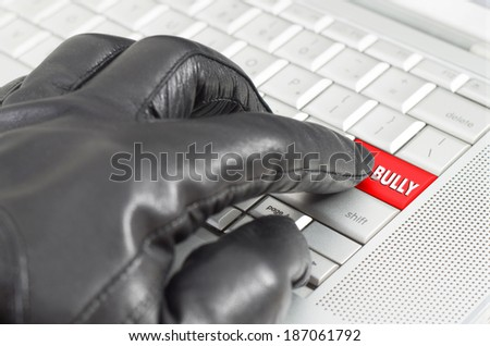 Online bully concept with hand wearing black glove  - stock photo