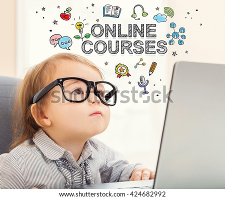 Online Courses concept with toddler girl using her laptop - stock photo