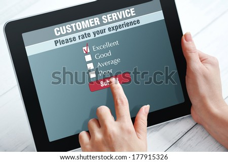 Online customer service satisfaction survey on a digital tablet - stock photo