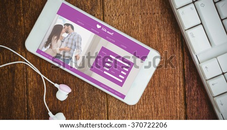 Online dating app against white smartphone with white headphones - stock photo