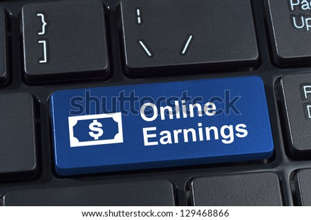 Online earnings computer keyboard button. Concept of earnings money with Internet technology. - stock photo