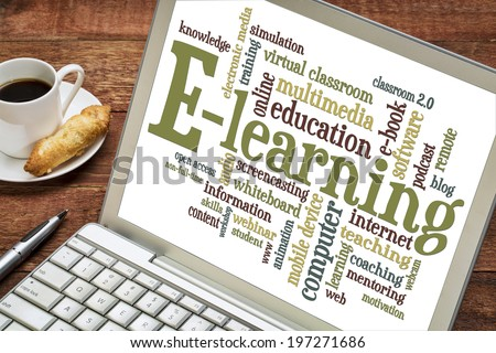 online education concept - e-learning word cloud on a laptop with a cup of coffee - stock photo