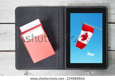 Online gambling in Canada concept with a tablet - stock photo