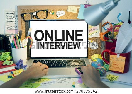 Online Interview / Business interview on internet with laptop - stock photo