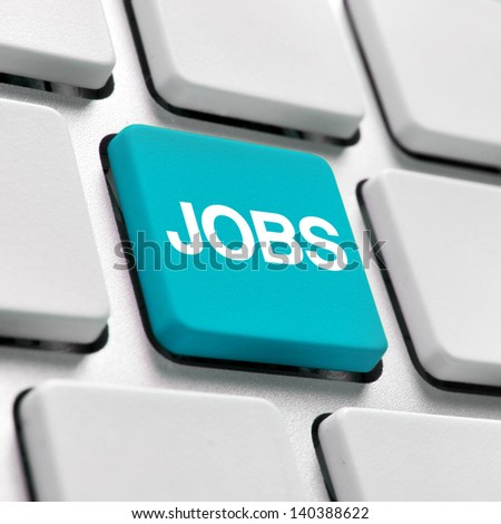 Online Job finder. Computer keyboard with blue JOB key. Applying for jobs on-line concept. - stock photo