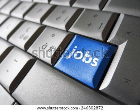 Online job search concept with jobs sign and symbol on a blue laptop computer key for website and online business.