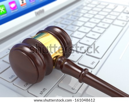 Online judgement. Gavel on laptop. Conceptual image. 3d - stock photo