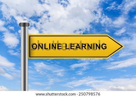 online learning words on yellow road sign on blue sky - stock photo