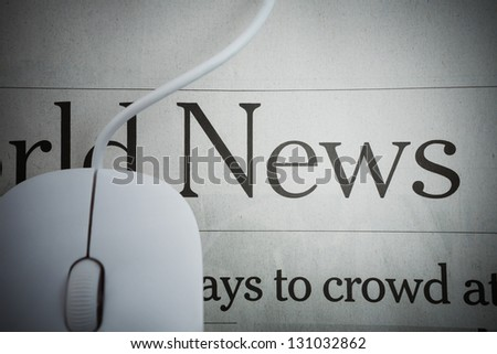 Online News -Computer mouse and Newspaper - stock photo