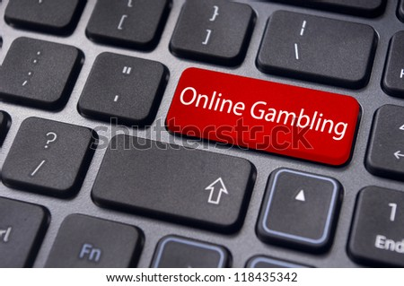 online or internet gambling concepts, with message on enter key of keyboard. - stock photo