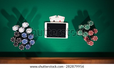 Online poker game app concept with digital tablet, cards and stacks of chips, top view - stock photo