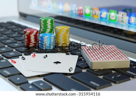 Online poker, virtual casino and gambling concept, four aces, deck of playing cards and colorful chips on computer laptop keyboard - stock photo
