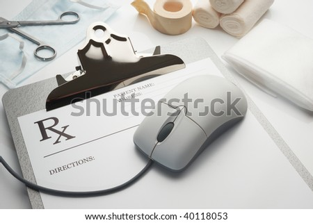 Online rx prescription concept clipboard with stethoscope and bandages - stock photo