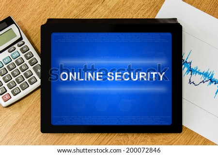 online security word on digital tablet with calculator and financial graph - stock photo