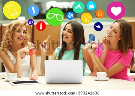 Online shopping. Beautiful young women with laptop and credit card - stock photo