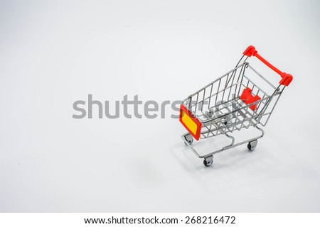 Online shopping, Black mouse in the shape of a shopping cart  - stock photo