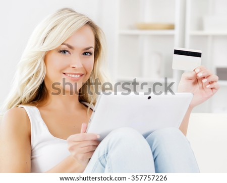 Online shopping concept. Beautiful blond girl with a credit card. - stock photo