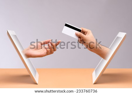 Online shopping concept: hand of man paying for his online purchases with credit card - stock photo