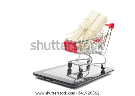 Online shopping concept - Shopping Cart,  tablet pc or smartphone, gift box isolated on white background. Copy space for text. Black friday - stock photo