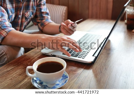 Online shopping.Hands holding credit card and using laptop. Personal loans - stock photo