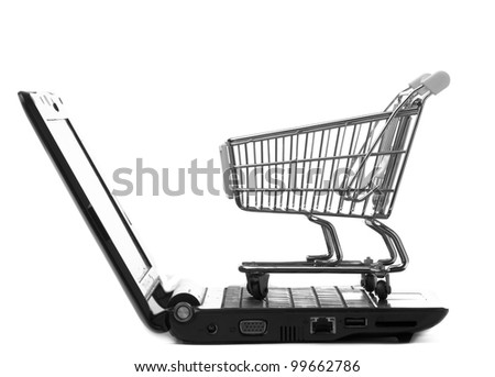 Online shopping. Shopping cart with notebook on the white. - stock photo