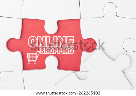 Online shopping, with text and shopping cart on puzzle - stock photo