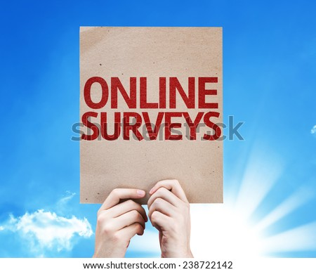 Online Surveys card with beautiful day - stock photo