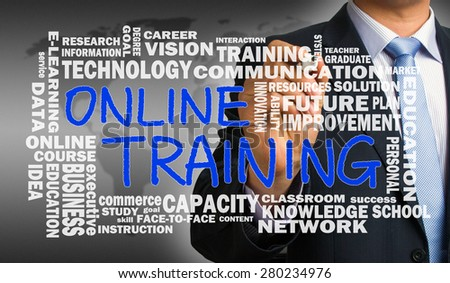 online training concept with related word cloud handwritten by businessman - stock photo