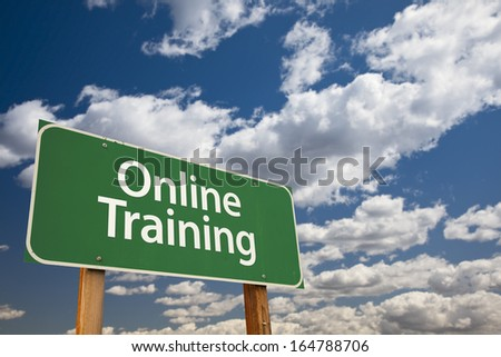 Online Training Green Road Sign with Dramatic Sky and Clouds. - stock photo
