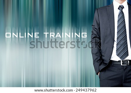 ONLINE TRAINING sign on blur background with standing businessman - stock photo