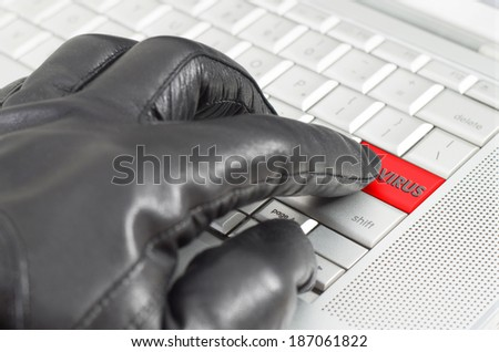 Online virus concept with hand wearing black glove  - stock photo