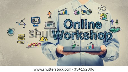 Online Workshop concept with young man holding a tablet computer  - stock photo